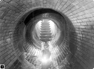 Interior of Victorian sewer, photographed in 1939. From the London Metropolitan Archives Photograph Library. Ref SC/PHL/02/ 0499. Copyright City of London: London Metropolitan Archives. Not to be reused without permission.
