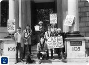 Photograph of Roland and Claire Muldoon, CAST and the Left Wing Teds dressed in their 'Double Bill' guises, protesting outside the Arts Council of Great Britain, [1984].