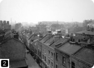 View of Prusom Street, Stepney, before slum clearance for Wapping Estate, 1925. From the London Metropolitan Archives Photograph Library. Ref SC/PHL/02/ 0735. Copyright City of London: London Metropolitan Archives. Not to be reused without permission.